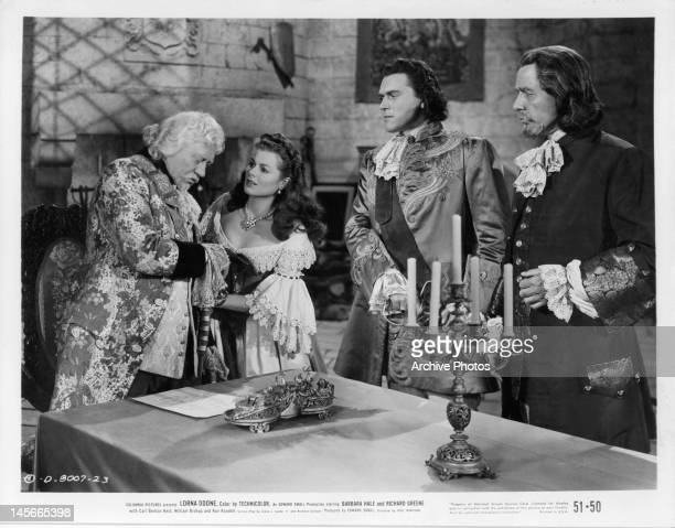 Barbara Hale pleading with older man as two others watch in a scene from the film 'Lorna Doone' 1951