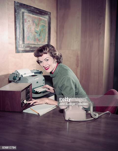 Barbara Hale Seated at Desk