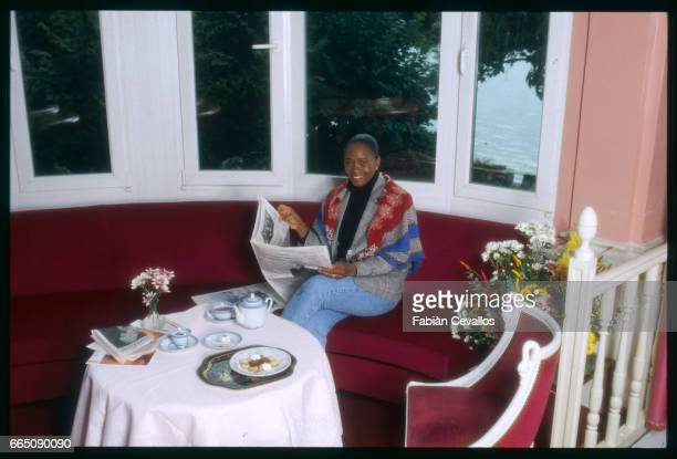 Barbara Hendricks reads a newspaper as she has breakfast in her living room