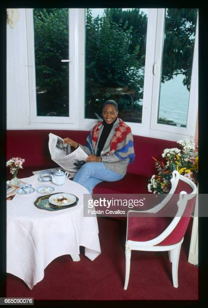 Barbara Hendricks reads a newspaper as she sits in her living room