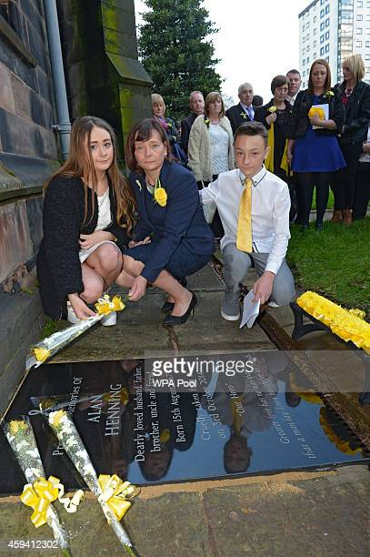 Barbara Henning and her children Lucy Henning and Adam Henning unveil a memorial stone at a memorial service for murdered British aid worker Alan...