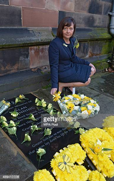 Barbara Henning the widow of Alan Henning unveils a memorial stone at a memorial service for murdered British aid worker Alan Henning at Eccles...