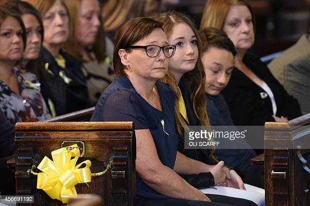 Barbara Henning the wife of murdered British aid worker Alan Henning and their children Lucy and Adam attend a quiet service of remembrance for Mr...