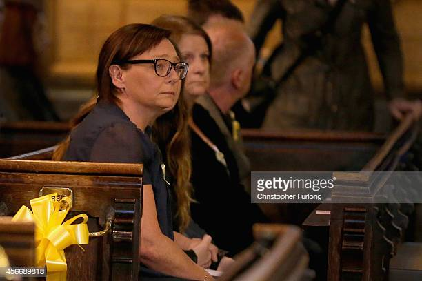 Barbara Henning wife of murdered aid volunteer Alan Henning sits with family members as they attend a 'service of reflection' to honour his life at...