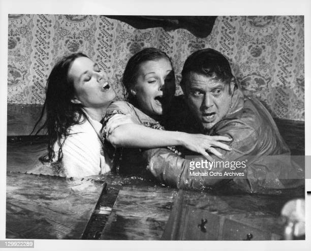 Barbara Hershey rescues Carol Lynley with Martin Milner's help in a scene from the film 'Flood' 1976
