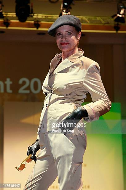 Barbara Herzsprung shows designs on the catwalk during the charity event 'Event Prominent' at the Hotel Grand Elysee on March 25 2012 in Hamburg...