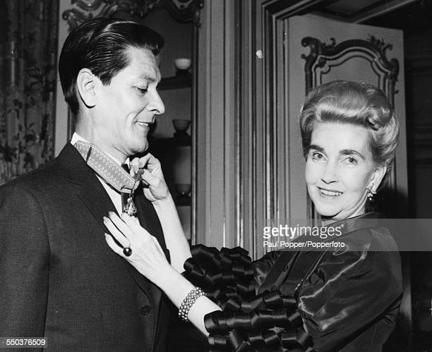 Barbara Hutton and her seventh husband Pierre Raymond Doan Prince de Champassak celebrate after he received the Laotian National Order of the Million...