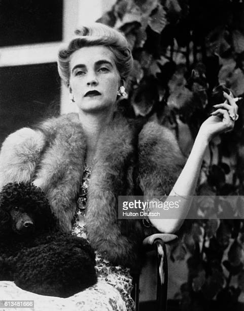 Barbara Hutton the grandaughter of FW Woolworth and heiress to the department store chain sits with her poodle 1954