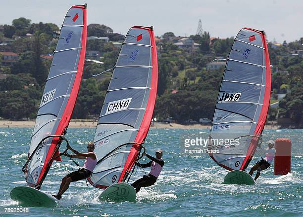 Barbara Kendall of New Zealand Mingli Duan of China and Yasuko Kosuge of Japan race up to the bottom mark on day two in Women's RSX Windsurfing...