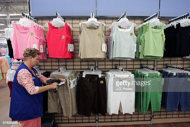 Barbara Kokensparger who has been working with WalMart for the past 11 years scans clothing items at the new 2000 square foot WalMart Supercenter...