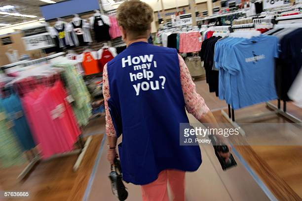 Barbara Kokensparger who has been working with WalMart for the past 11 years walks to the children's clothing area to scan items at the new 2000...