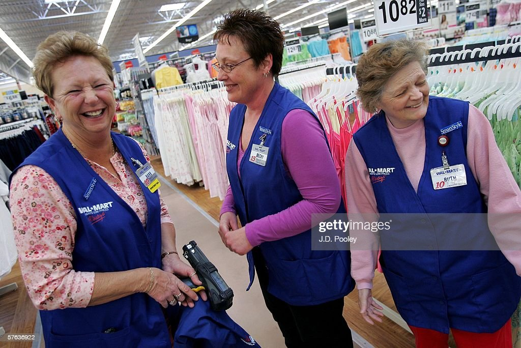 Barbara Kokensparger, who has been working with Wal-Mart for the past 11 years, shares a laugh with Becky Lientz, who has been with the company for 16 years, and Ruth Burkey, who has been with the Wal-Mart company for 12 years, inside the new 2,000 square foot Wal-Mart Supercenter store May 17, 2006 in Bowling Green, Ohio. The new store, one of three new supercenters opening today in Ohio, employs 340 people with 60 percent of those working full-time.