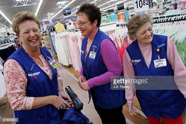 Barbara Kokensparger who has been working with WalMart for the past 11 years shares a laugh with Becky Lientz who has been with the company for 16...