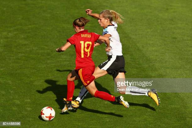 Barbara Latorre of Spain and Carina Wenninger of Austria battle for possession during the UEFA Women's Euro 2017 Quarter Final match between Austria...