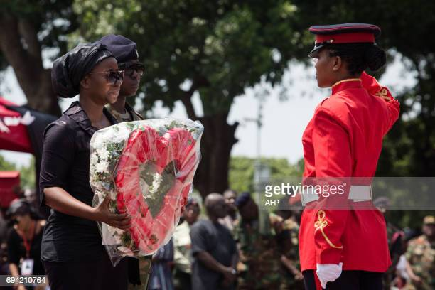 Barbara Mahama , the widow of late Major Maxwell Mahama, lays a wreath during her late husband's state funeral ceremony on June 9, 2017 in Accra....