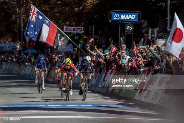Barbara Malcotti of Italy, Simone Boilard of Canada, winner Laura Stigger of Austria and Marie Le Net of France on the finish line during the Women...