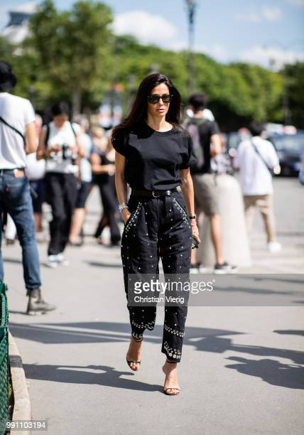 Barbara Martelo wearing black cropped pants and tshirt is seen outside Chanel on day three during Paris Fashion Week Haute Couture FW18 on July 2...