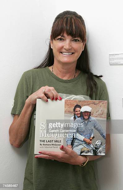 Barbara McQueen wife of actor Steve McQueen poses with her book Steve McQueen Photographs from the Last Mile at The Movie Poster Art Gallery on June...