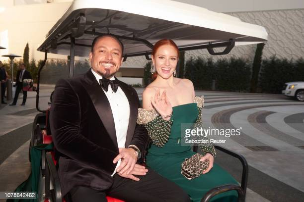 Barbara Meier and her fiance Klemens Hallmann pose in a golf cart that will take them to the red carpet of the 76th annual Golden Globe Awards at...