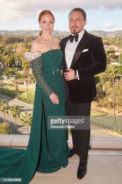 Barbara Meier and her fiance Klemens Hallmann pose on the balcony of her hotel suite ahead of the 76th annual Golden Globe Awards at Waldorf Astoria...