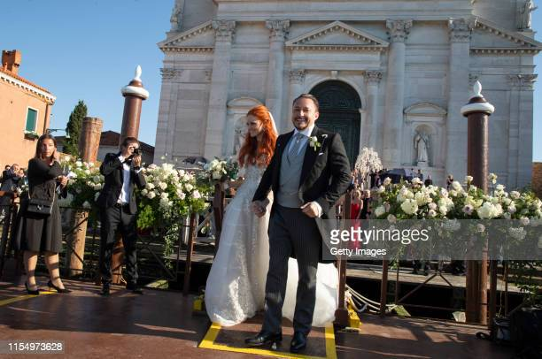 Barbara Meier and Klemens Hallmann are seen in front of the Chiesa del Santissimo Redentore during the wedding ceremony of Barbara Meier and Klemens...