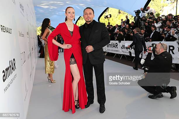 Barbara Meier and Klemens Hallmann attend the amfAR's 23rd Cinema Against AIDS Gala at Hotel du CapEdenRoc on May 19 2016 in Cap d'Antibes France