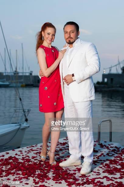 Barbara Meier and Klemens Hallmann attends the wedding of Victoria Swarovski and Werner Muerz on June 15, 2017 in Trieste, Italy.