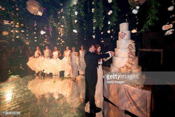 Barbara Meier and Klemens Hallmann cut the wedding cake during their wedding celebration on June 1 2019 in Venice Italy