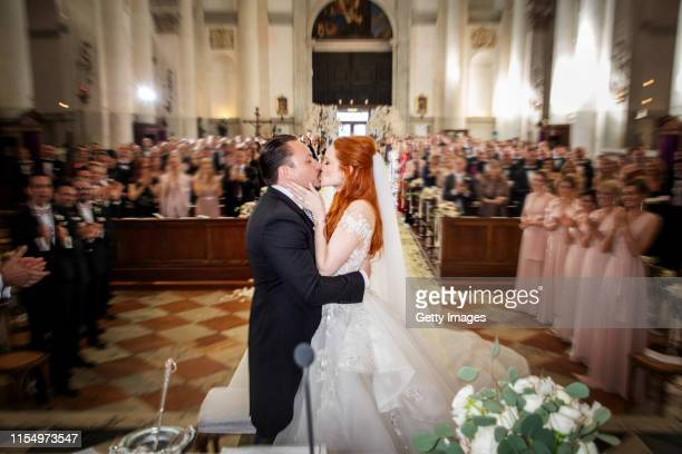Barbara Meier and Klemens Hallmann kiss during their wedding ceremony at the Chiesa del Santissimo Redentore on June 01 2019 in Venice Italy