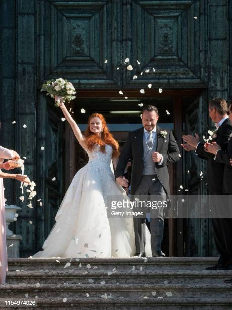 Barbara Meier and Klemens Hallmann leave the Chiesa del Santissimo Redentore after their wedding ceremony on June 01 2019 in Venice Italy