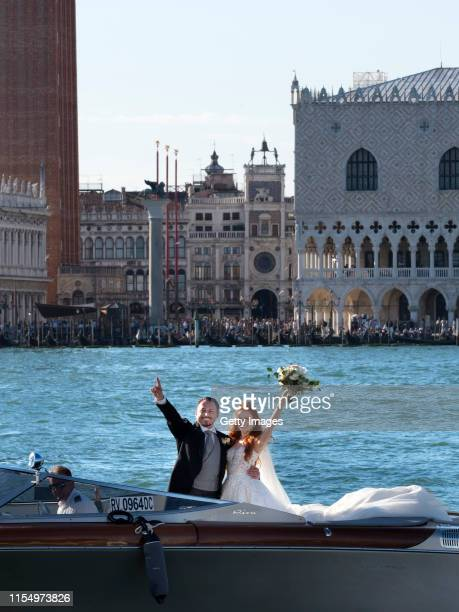 Barbara Meier and Klemens Hallmann ride on a motor baot during their wedding celebration on June 01 2019 in Venice Italy