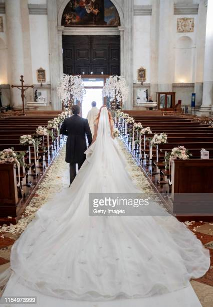 Barbara Meier and Klemens Hallmann walk out of the Chiesa del Santissimo Redentore after their wedding ceremony on June 01 2019 in Venice Italy