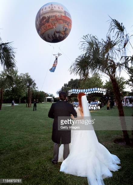 Barbara Meier and Klemens Hallmann watch the hot air balloon performance during their wedding celebration on June 01 2019 in Venice Italy