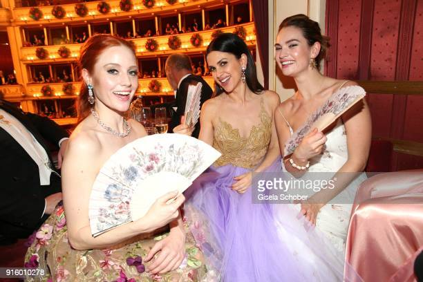 Barbara Meier and Viktoria Lauterbach wearing jewelry by Thomas Jirgens 'Juwelenschmiede' and Lili James during the Opera Ball Vienna at Vienna State...