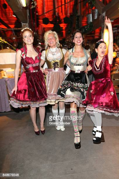 Barbara Meier Ellen von Unwerth Lola Paltinger Viktoria Lauterbach are all wearing a dirndl by Lola Paltinger during the 'Almauftrieb' as part of the...