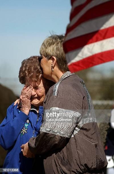 Barbara Mikulik of Houston kisses her 91yearold mother Hilda Mikulik of San Angelo Texas before the memorial service for space shuttle Columbia...