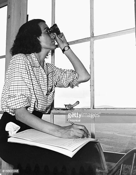 Barbara Mortensen spotter for the local interceptor command keeping watch on Pine Mountain When spotting use of binoculars is restricted to...