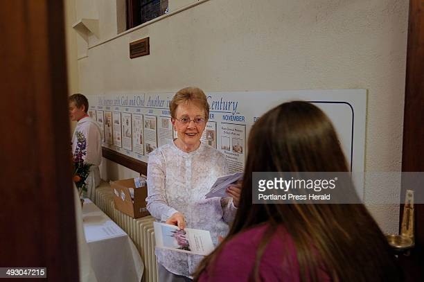 Barbara Nee who has been a lifelong parishoner at St John the Evangelist Catholic Church in South Portland hands out programs at the church's final...