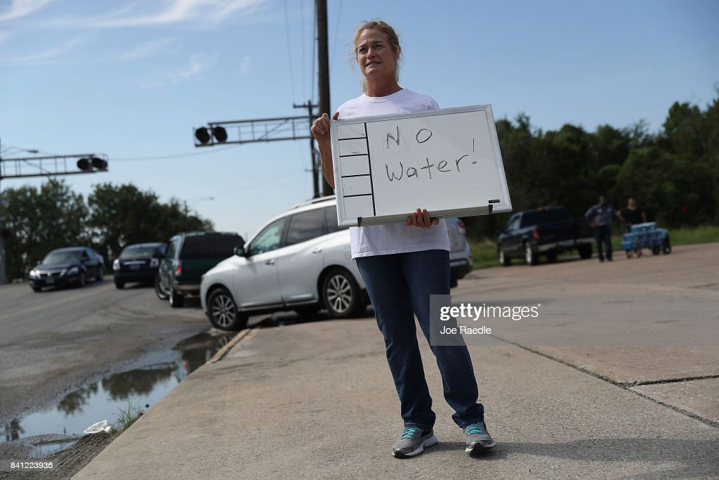 Barbara Nelson from Coastal Industrial and Specialty gas welding supplies store holds a sign that reads, 'no water', after they ran out of bottled water for people that are in need after the water supply to the city of Beaumont was shut down after Hurricane Harvey passed through on August 31, 2017 in Beaumont, Texas. Harvey, which made landfall north of Corpus Christi August 25, has dumped more than 50 inches of rain in some areas in and around Houston.