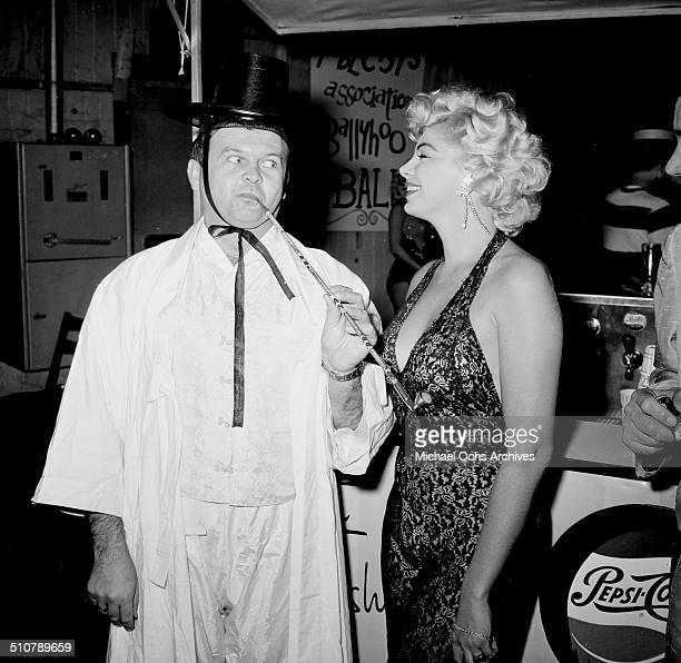Barbara Nichols and Johnny Grant attend a Halloween party in Los AngelesCA