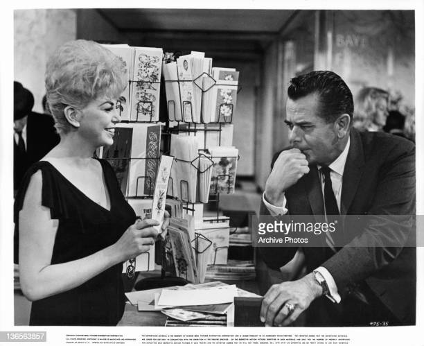 Barbara Nichols showing greeting card to Glenn Ford in a scene from the film 'Dear Heart' 1964