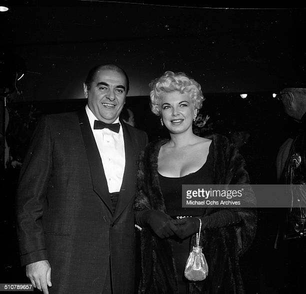 Barbara Nichols with Bob Middleton attend the movie premiere of Bundle of Joy in Los AngelesCA