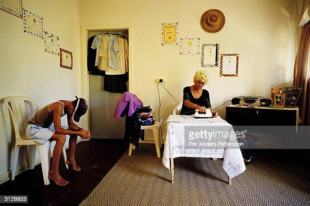 Barbara Noortman irons the family's clothes in her living room on December 12 2003 in Orania in the Northern Cape province South Africa Barbara moved...