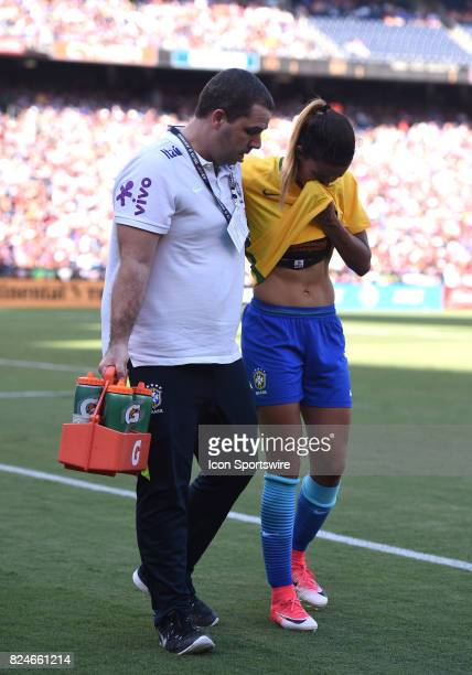 Barbara of Brazil is helped off the field after sustaining an injury during the Tournament of Nations soccer match between USA and Brazil on July 30...