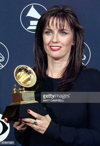 Barbara Orbison widow of Roy Orbison holds a Grammy Award 25 February in New York Orbison was presented with a Lifetime Achievement Award AFP PHOTO...