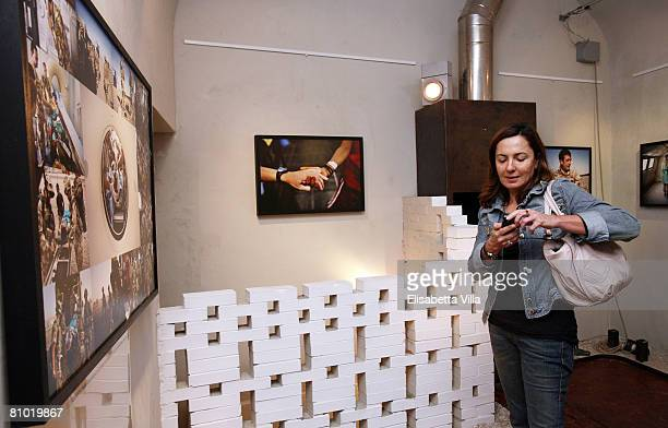 Barbara Palombelli attends the Casualties of the Nameless Opening Exhibition by Italian photographer Marco Di Lauro held at MOCA Studio on May 07...