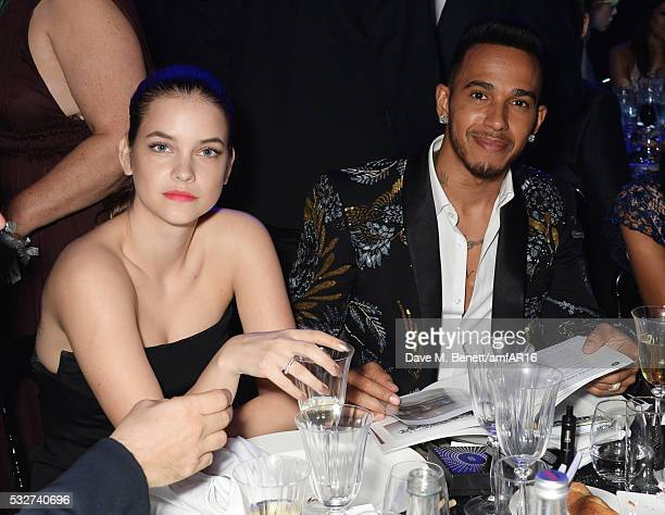 Barbara Palvin and Lewis Hamilton attend amfAR's 23rd Cinema Against AIDS Gala at Hotel du CapEdenRoc on May 19 2016 in Cap d'Antibes France