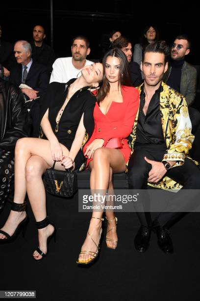 Barbara Palvin Emily Ratajkowski and Jon Kortajarena attend the Versace fashion show on February 21 2020 in Milan Italy