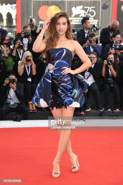 Barbara Palvin walks the red carpet ahead of the opening ceremony and the 'First Man' screening during the 75th Venice Film Festival at Sala Grande...