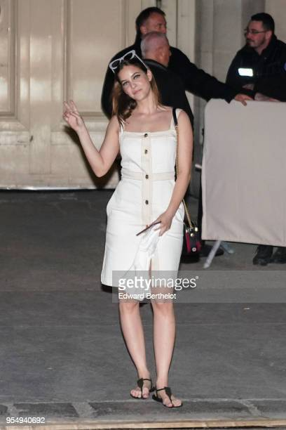 Barbara Palvin wears a white dress outside the Chanel Cruise 2018/2019 Collection at Le Grand Palais on May 03 2018 in Paris France
